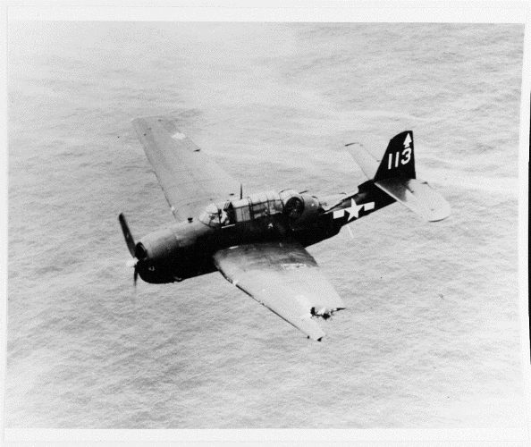 A black and white photo of the avenger. Avengers were considered extremely rugged. In February 1945, this Avenger suffered major damage to the top of the fuselage and left wing by anti-aircraft fire over the Japanese island Chichijima. The damaged aircraft flew 100 miles back to its ship, USS Bennington (CV-20). After crash-landing in the water, all crew members were rescued. Photo credit: Naval History and Heritage Command