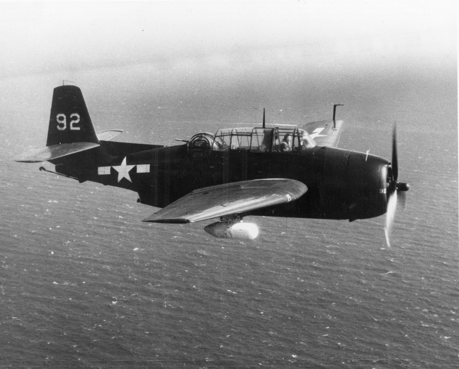 A black and white photo of the TBM-3E version of the Avenger carried surface search radar in a pod under the wing. This radar system helped to locate targets across vast stretches of open water. Photo credit: U.S. Navy