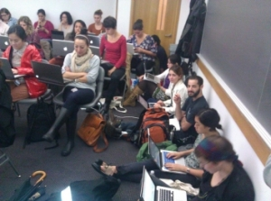 Students sit in the aisles of a packed classroom for theNYU-Codeacademy course, led by Professor Liel Leibovitz.