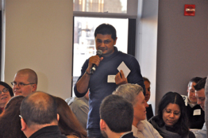 Him Mistry proposes a topic during the agenda-settingphase of the meeting. Photo by Jeff Bary