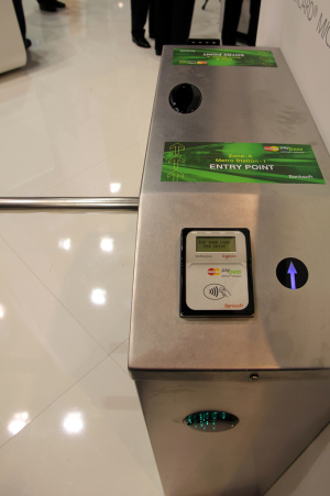 An exhibition at Cartes, an industry conference, demonstratesthe use of NFC technology to sell transportation faresat the turnstile. (Image source: Flickr)