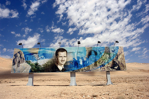 512px-Roadside_mural_of_Bashar_al_Assad_along_the_Damascus-Aleppo_highway