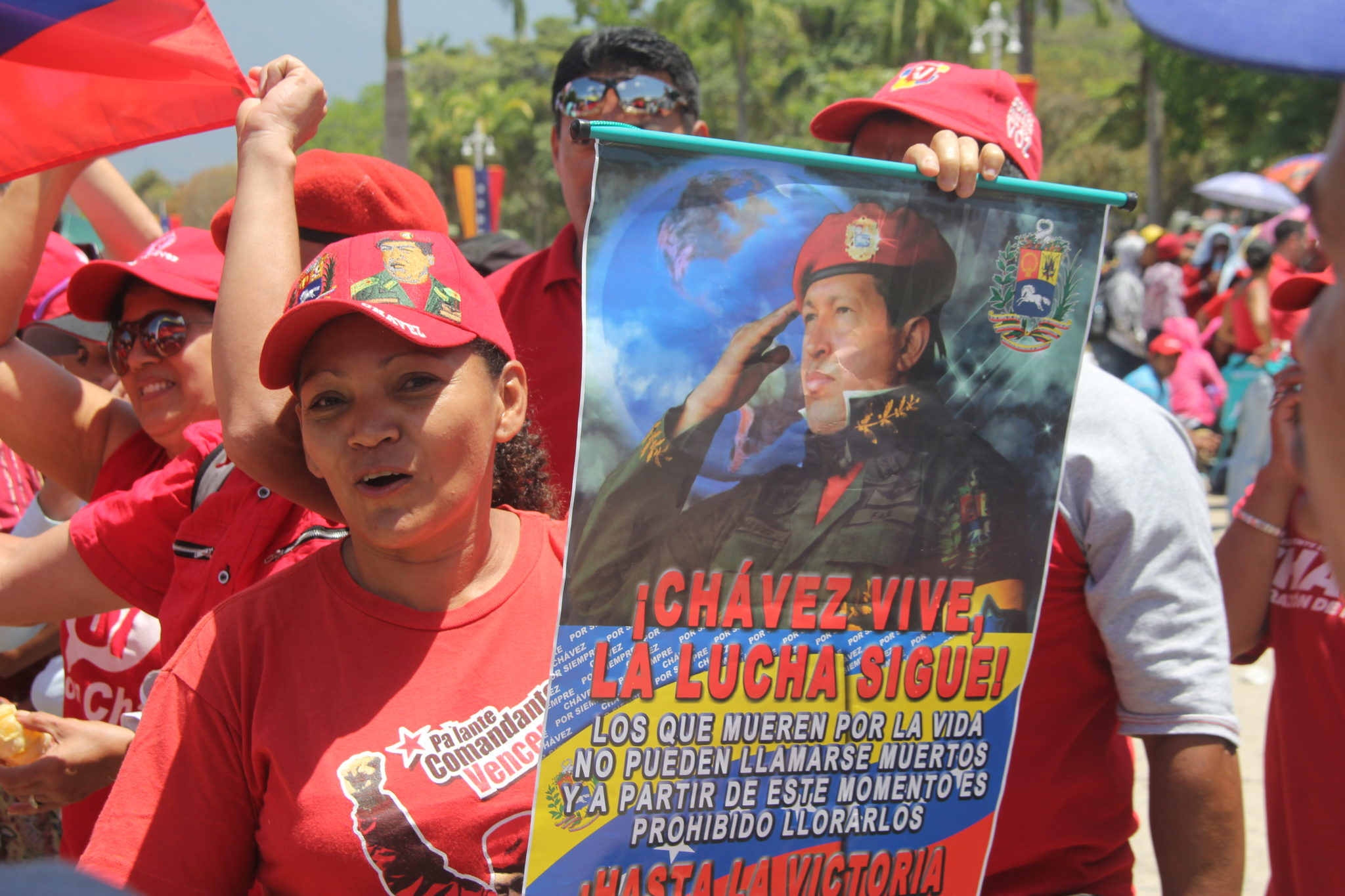 "A few days before Chavez's state funeral, a crowd gathers to chant ""Chavez Vive. La lucha sigue,"" which translates to Chavez lives. The struggle continues. Millions of people would line up to see Chavez's body  lying in state. Photo by Ezra Fieser."