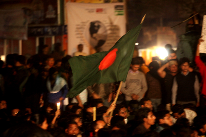 Protestors at Shahbag Square wave the Bangladesh flag, February 6, 2013. Image via Wikicommons. Photo credit: Kabir Hossain