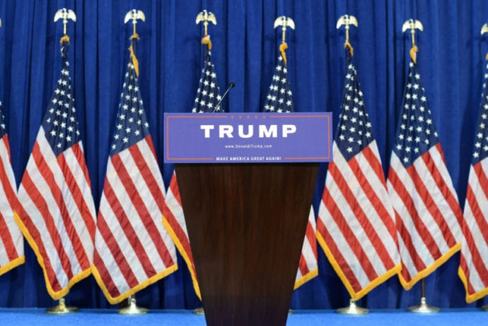 Empty podium before real estate mogul and TV personality Donald Trump announces his candidacy for the Republican party nomination for President of the United States during a press conference at the Trump Tower on Fifth Avenue in New York, NY, on June 16, 2015.  (Photo by Anthony Behar) *** Please Use Credit from Credit Field ***