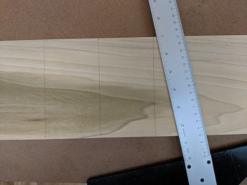 ruler on top of measured wood